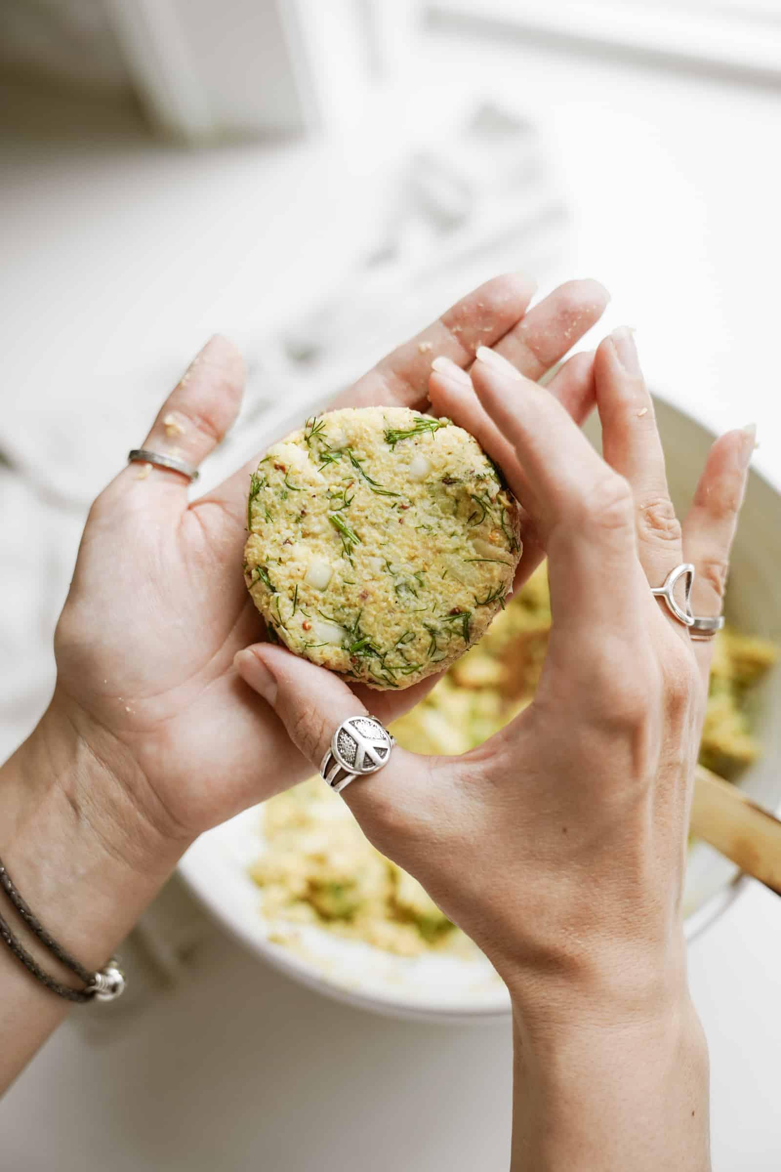 Hands forming vegan crab cakes