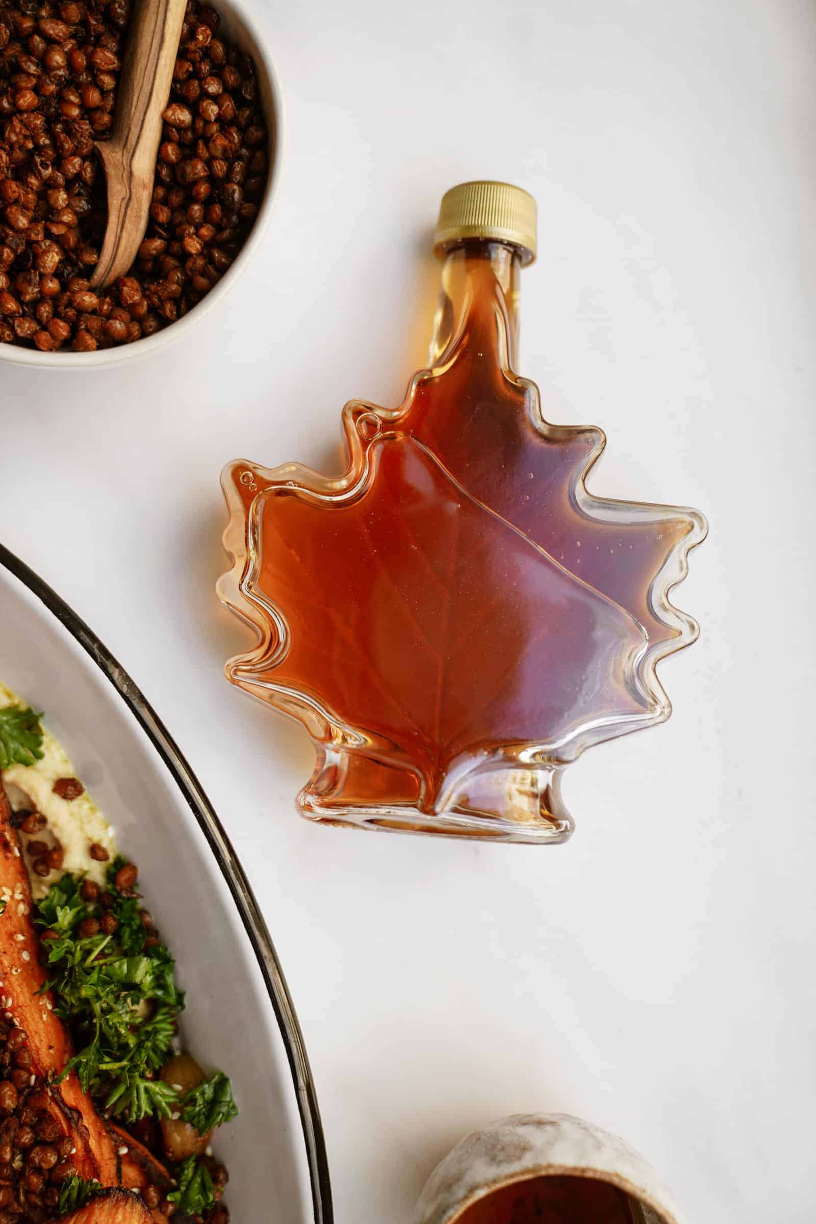 Bottle of Canadian maple syrup on a counter