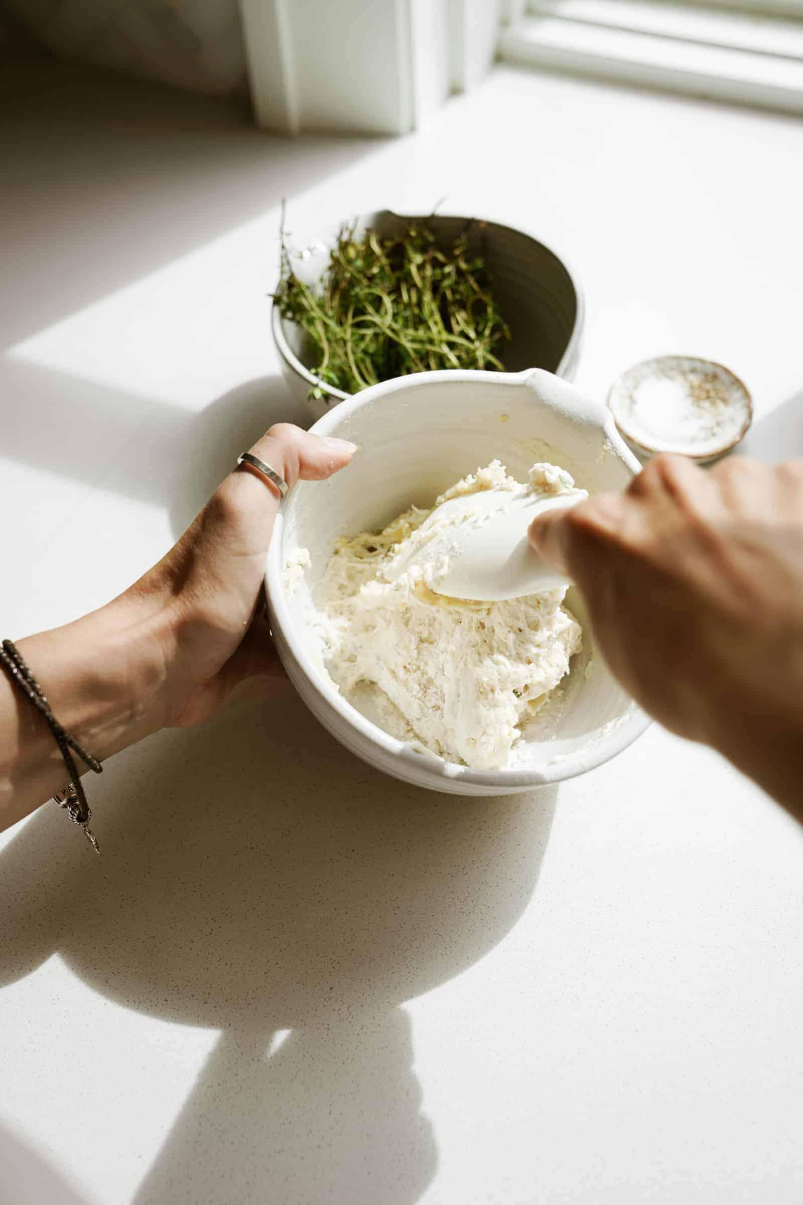 Ingredients for vegan dumplings being mixed in a bowl