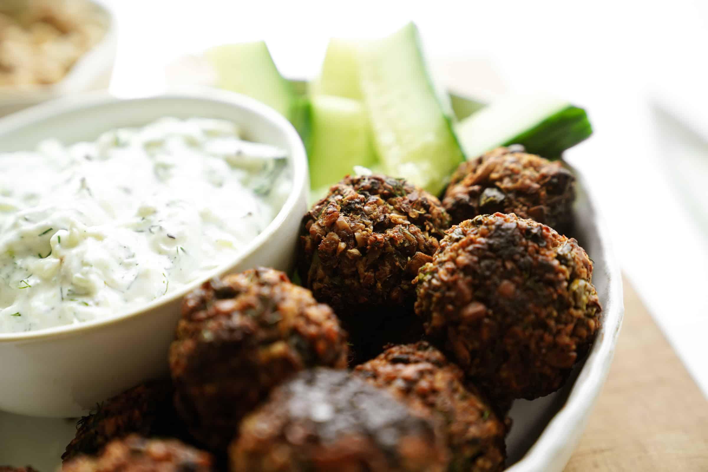 Walnut meatballs close-up on a serving dish
