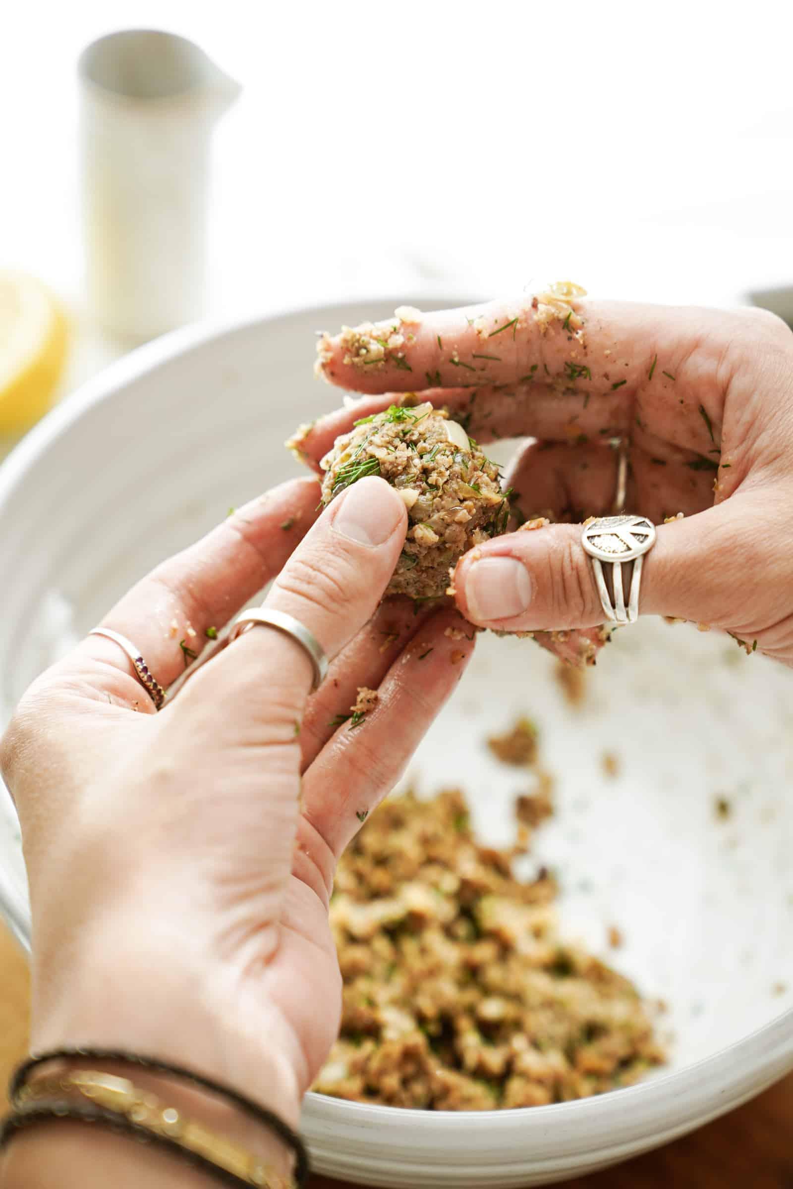 Forming walnut meatballs into balls