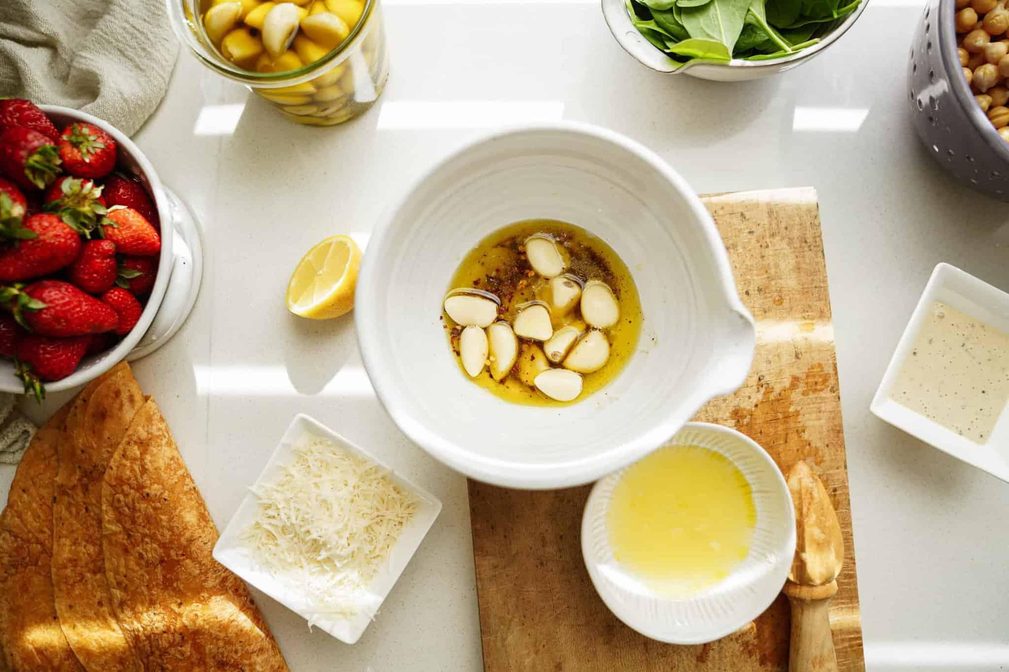Ingredients for garlic confit for chickpea caesar salad wrap recipe