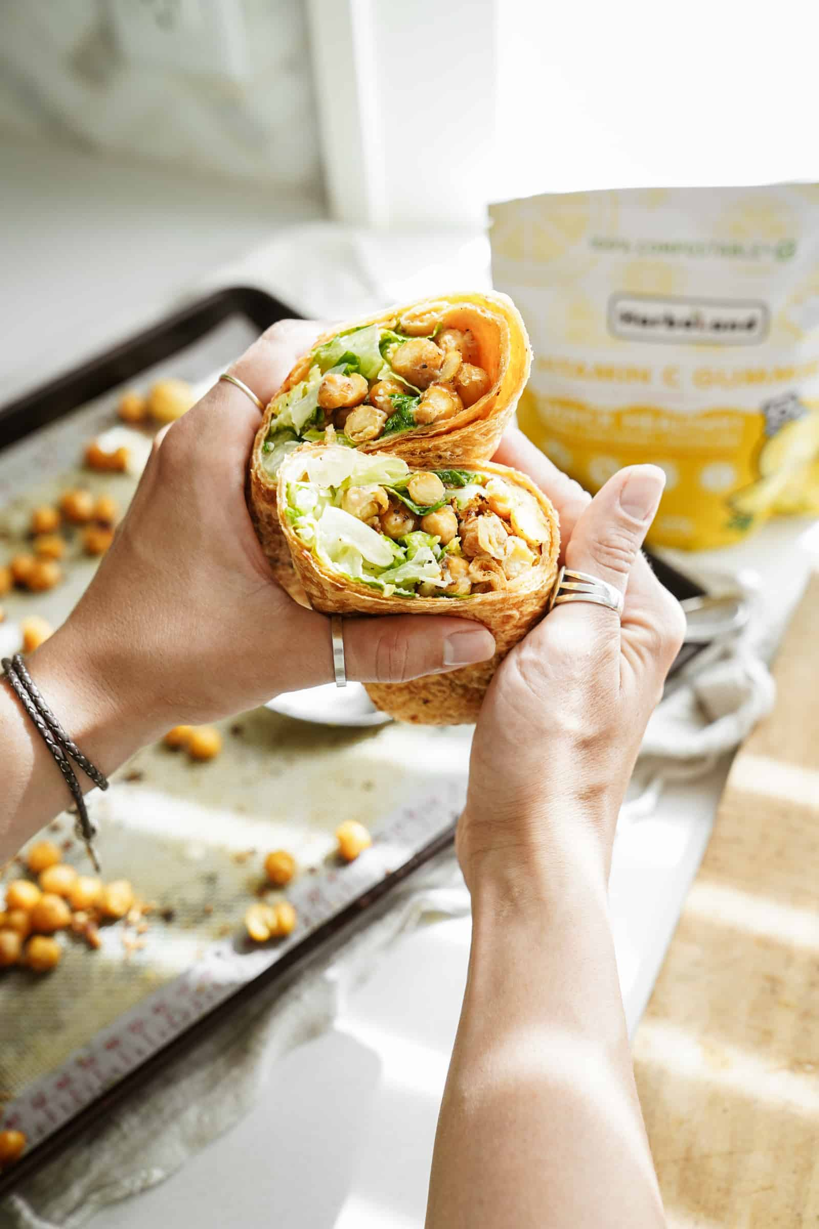 Chickpea caesar salad wrap with gummies in the background