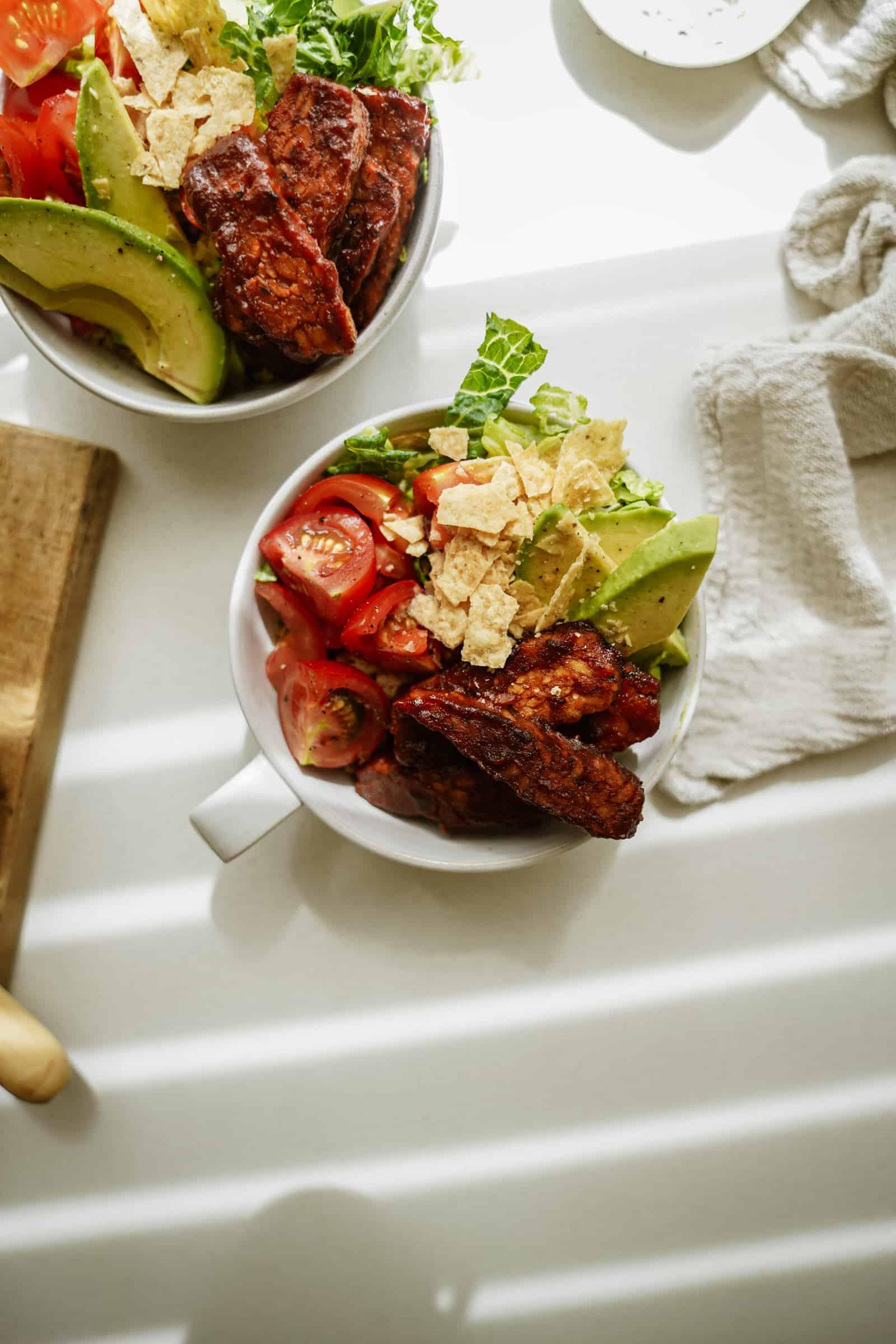 BBQ tempeh bowl with fresh veggies in a bowl