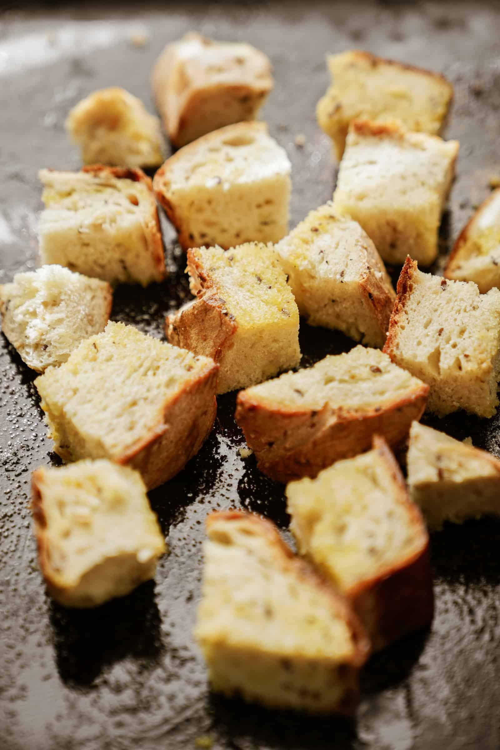 Crispy croutons on a baking sheet