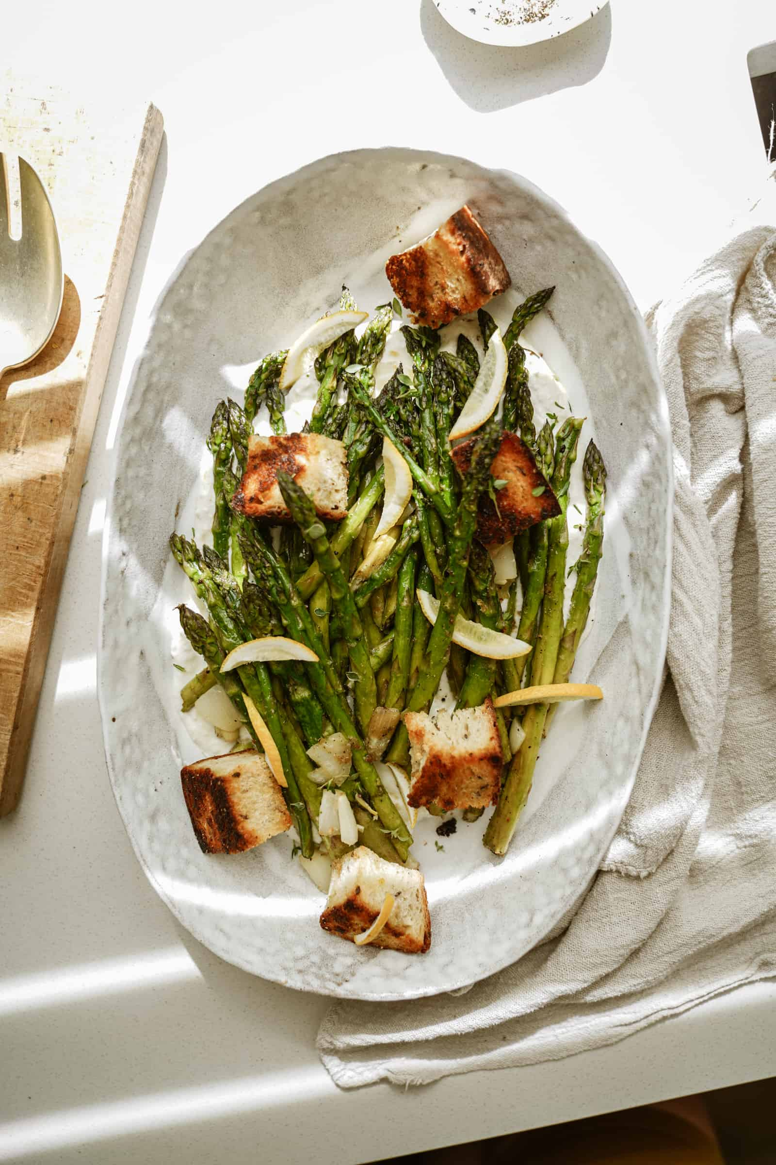 Greek marinated asparagus in serving dish