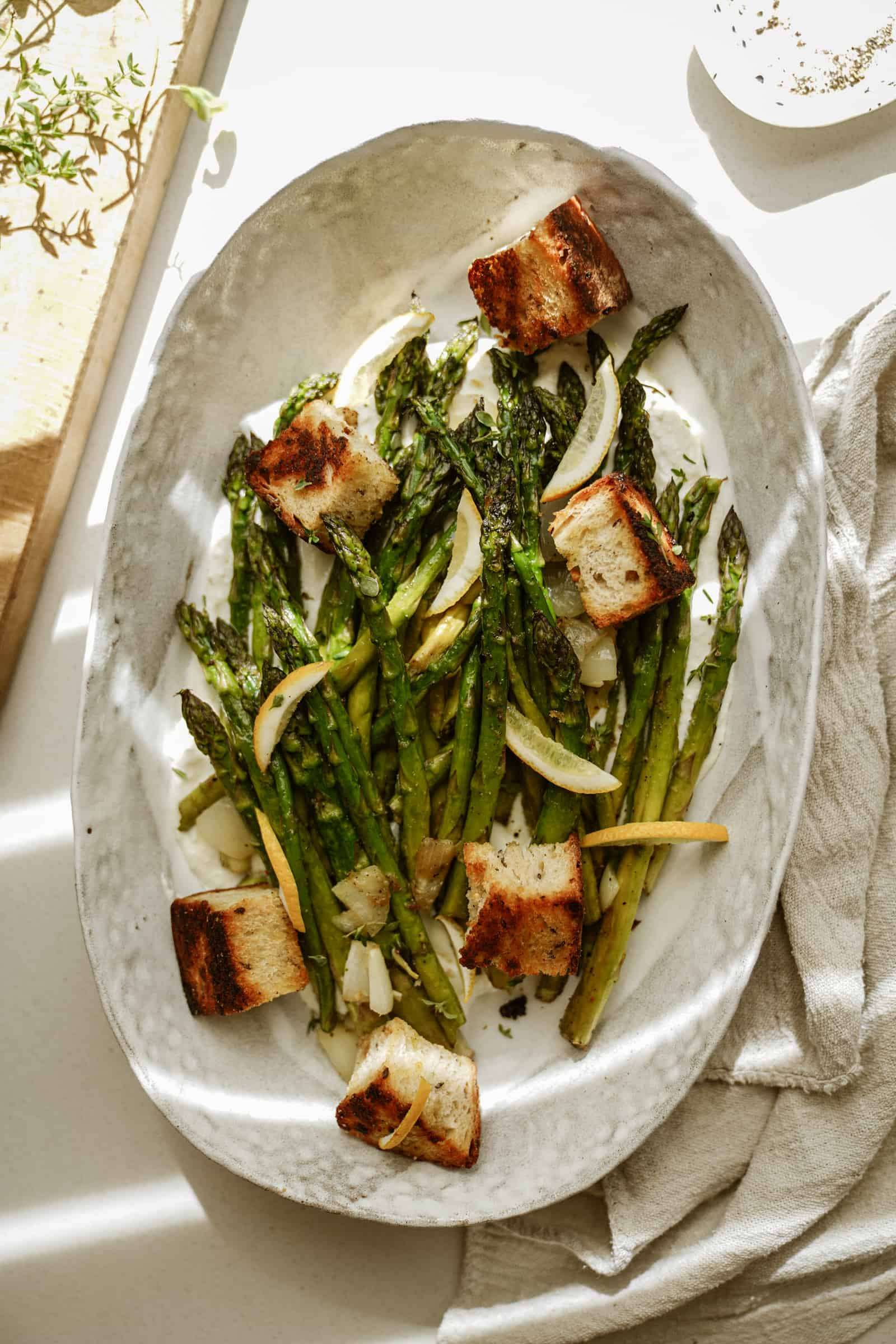 Greek marinated asparagus on a serving dish