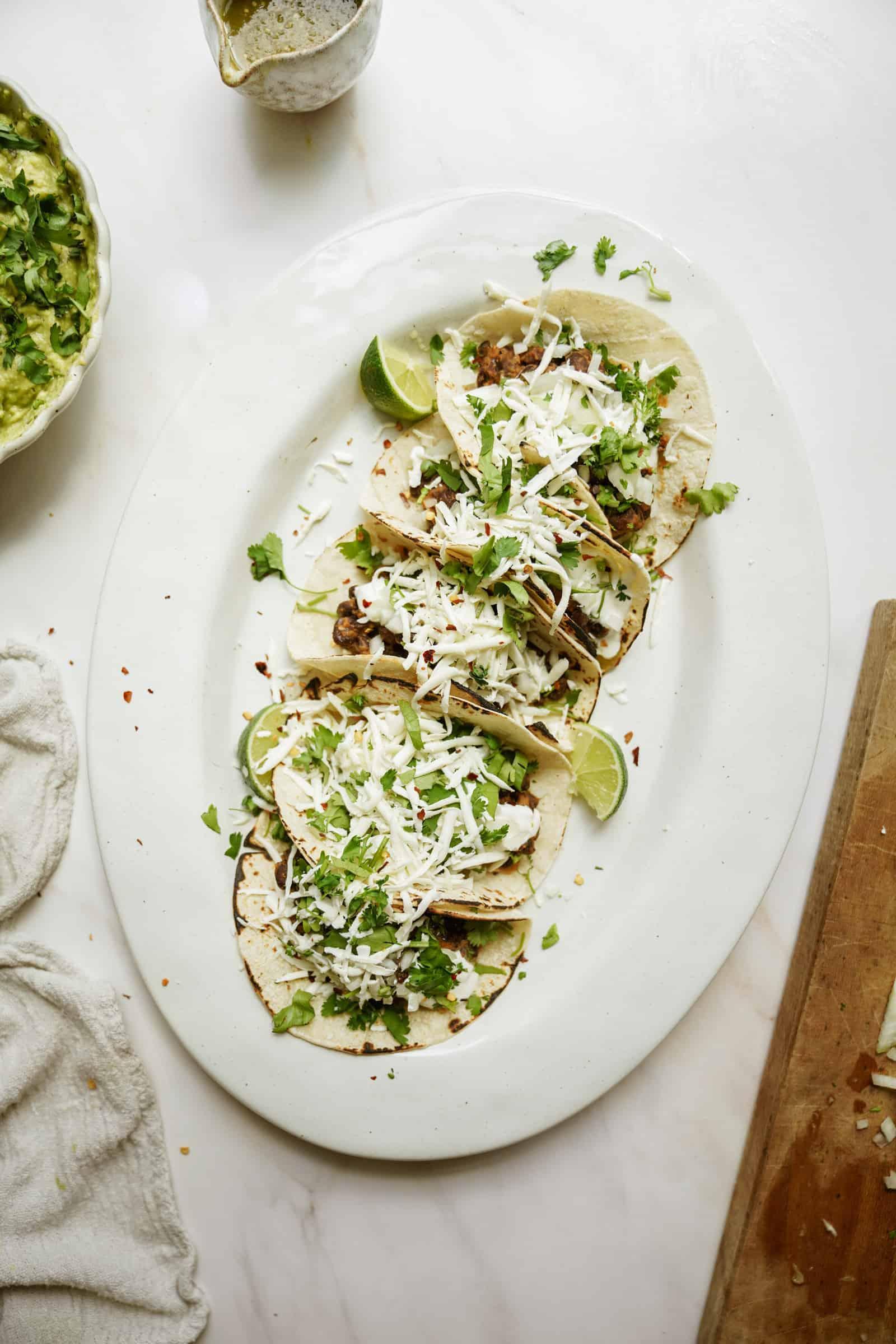 Vegetarian black bean tacos on a platter
