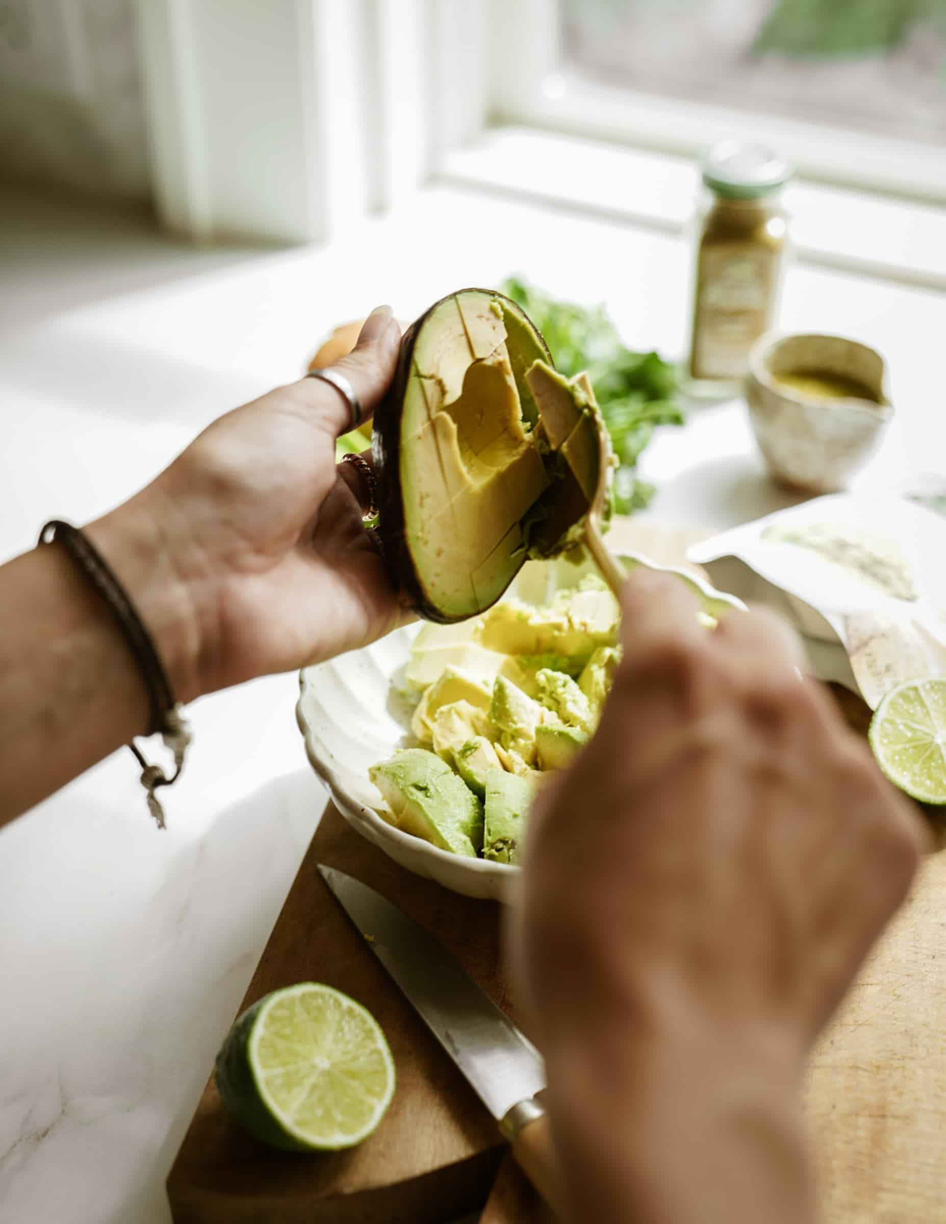 Scooping avocado out of a avocado