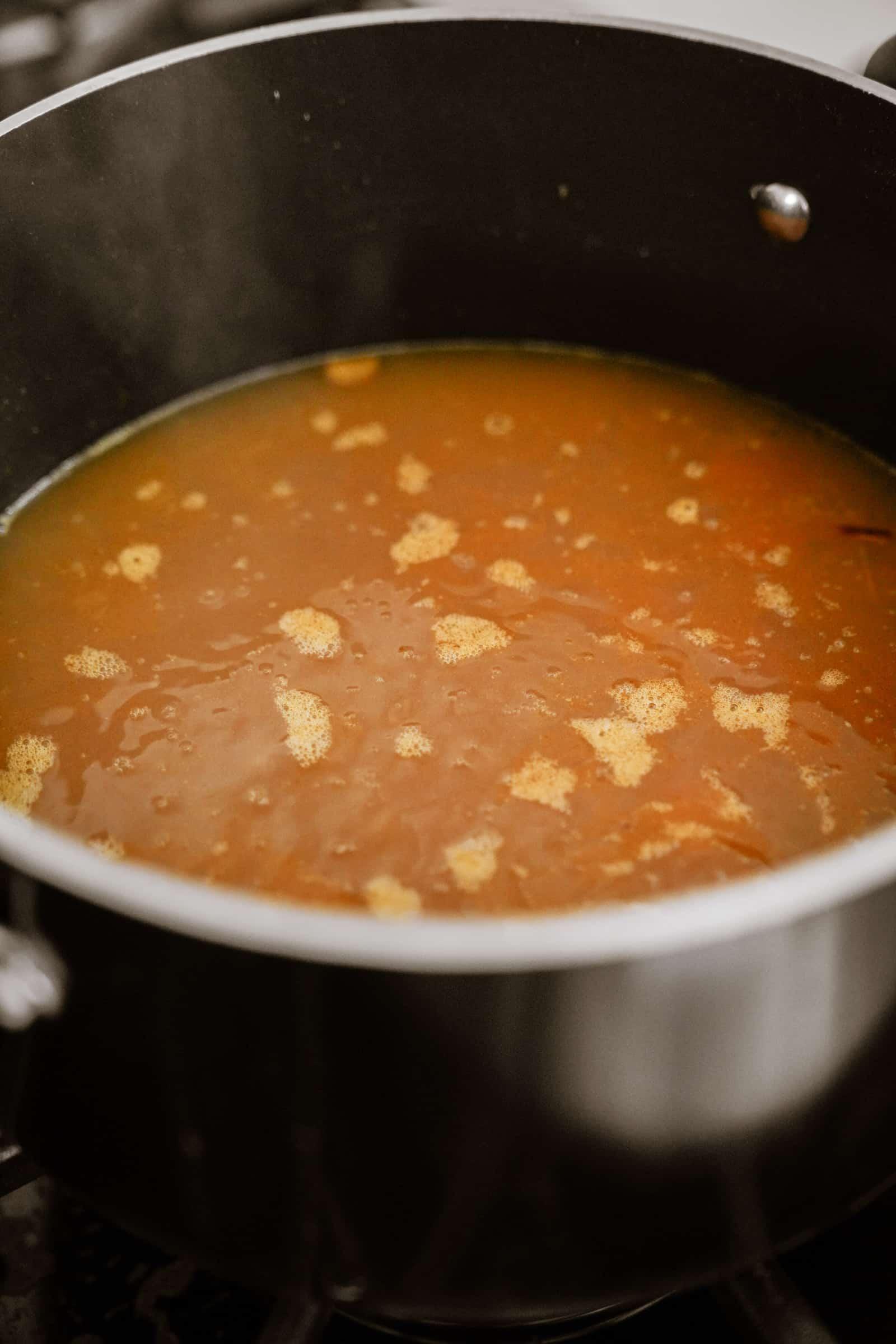 Lemon rice soup cooking in a pot