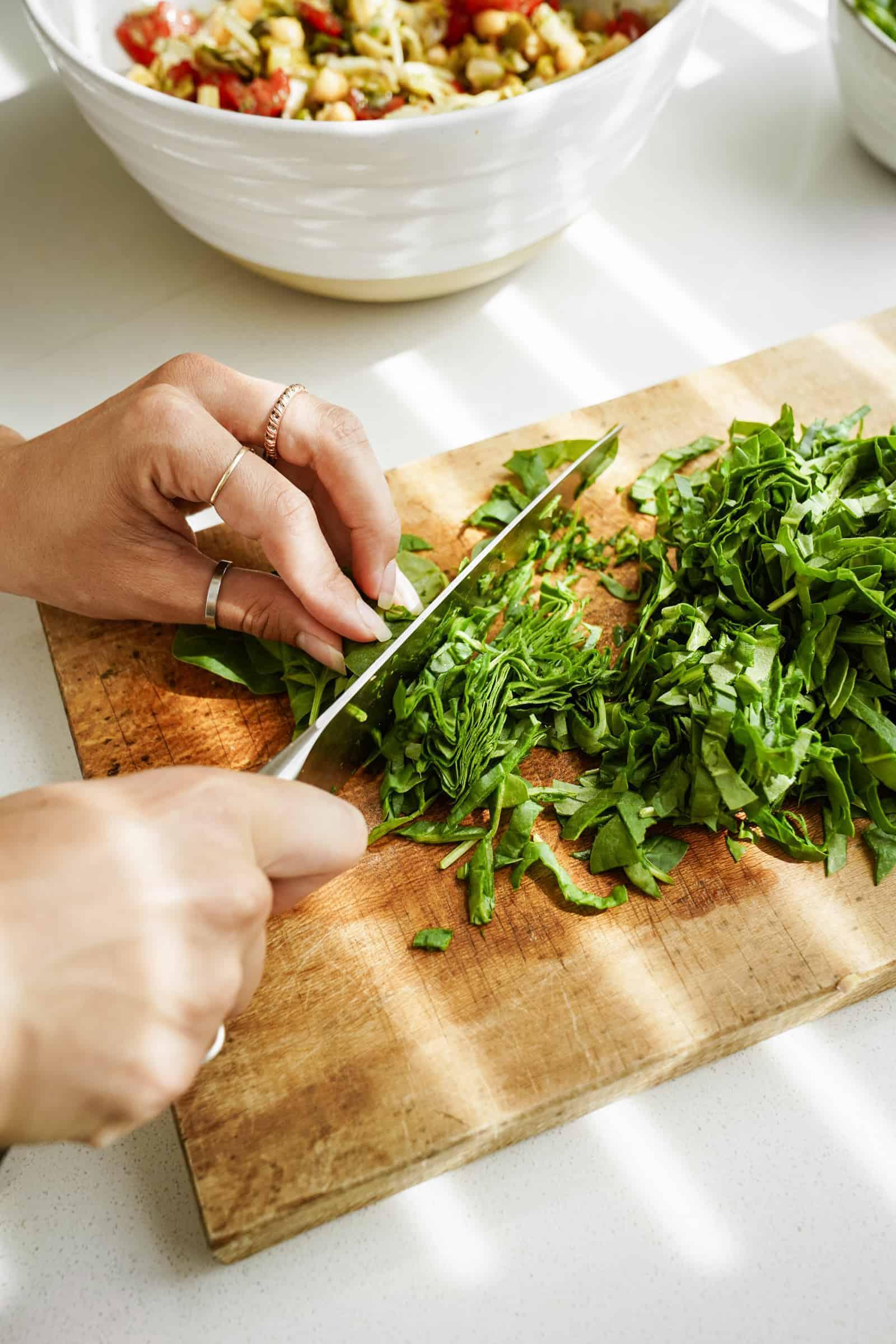 Chopping parsley on a cutting board