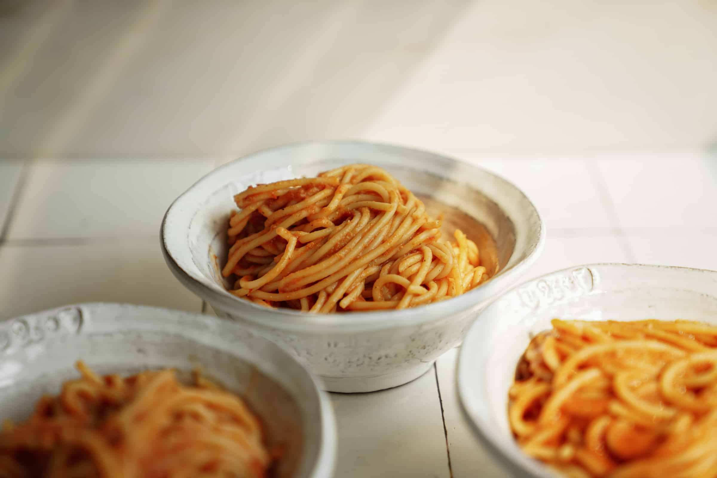 Bowls of spaghetti with Greek pasta sauce on it