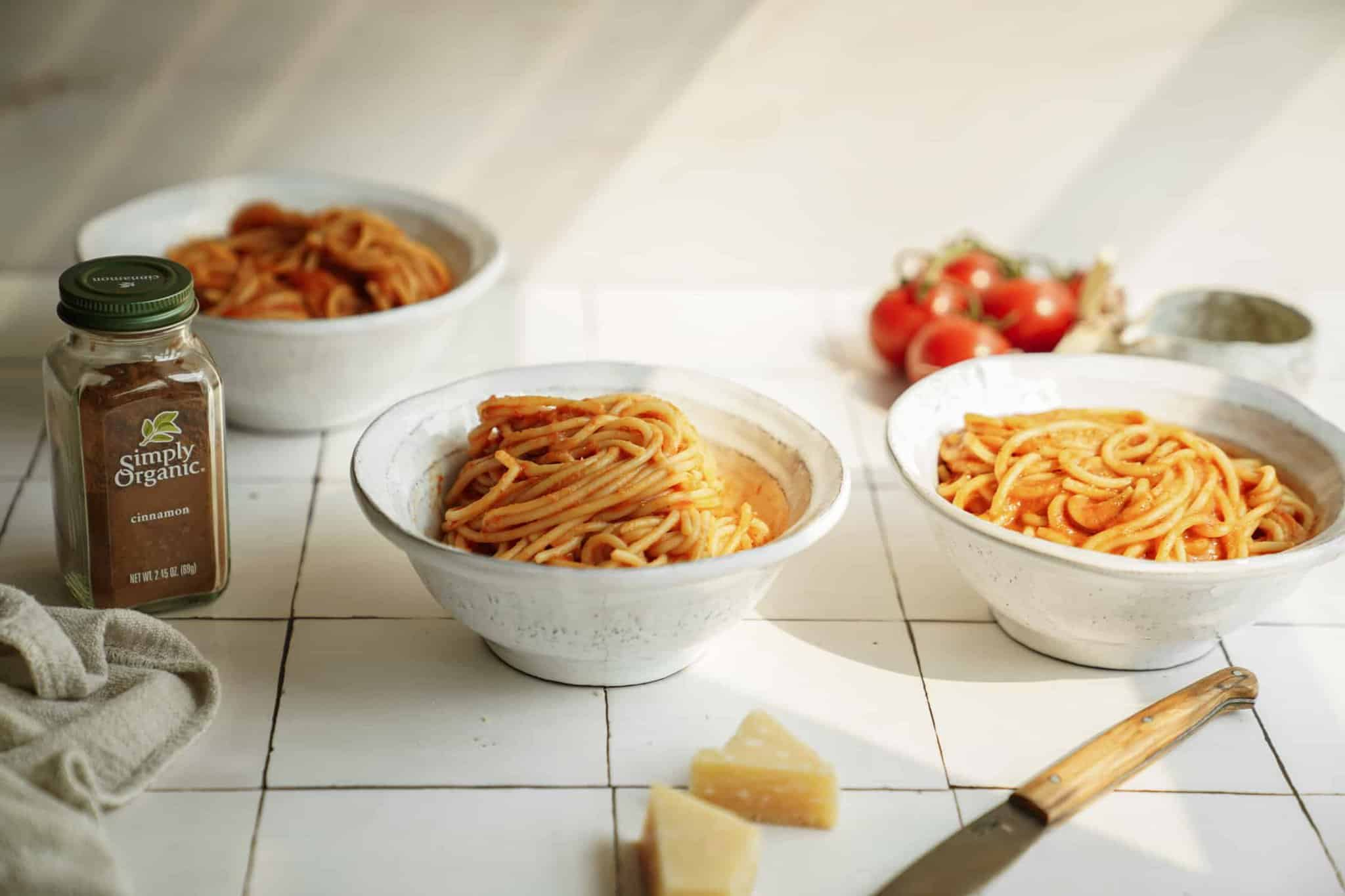 Bowls of spaghetti on a counter