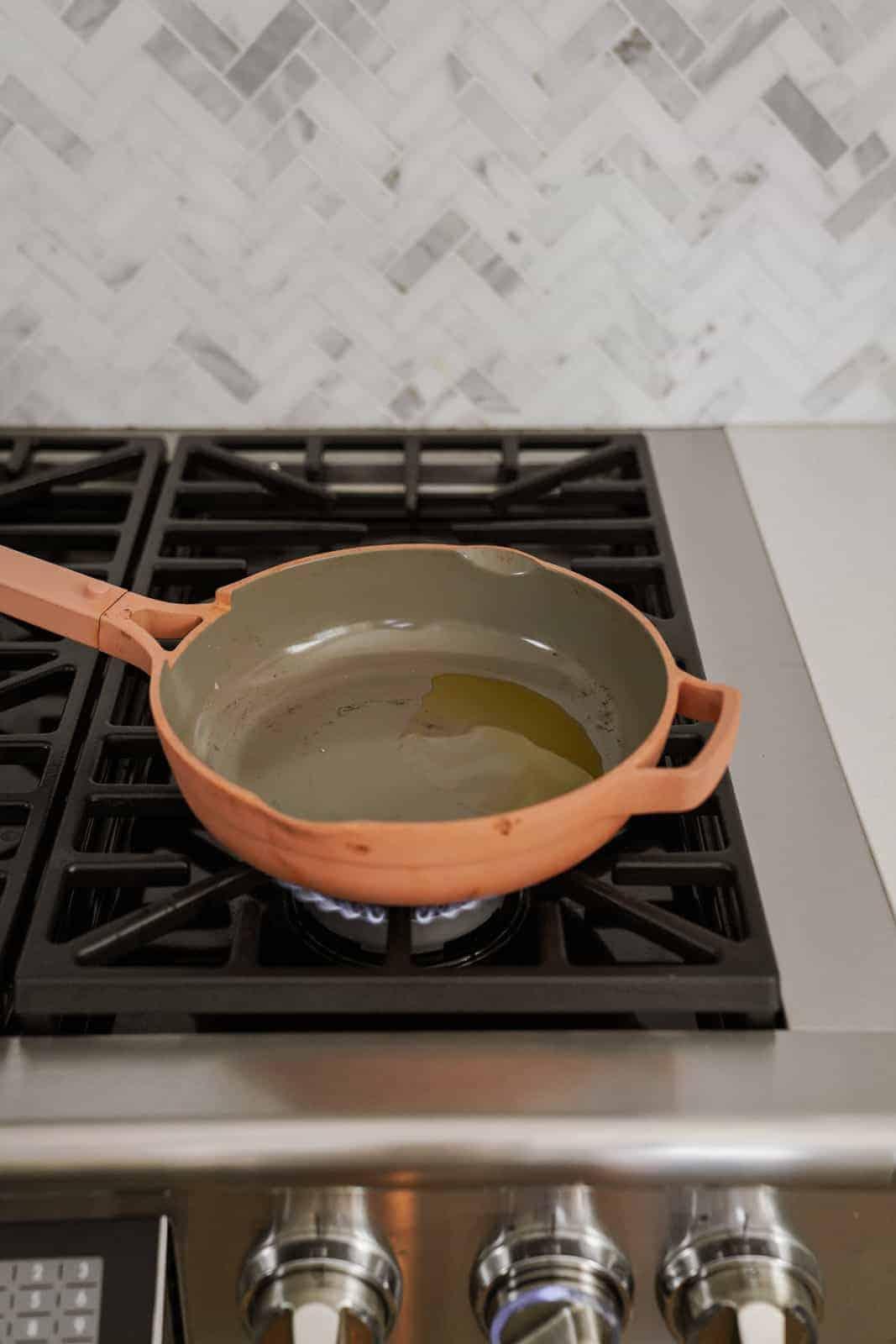 Olive oil in pot on stove