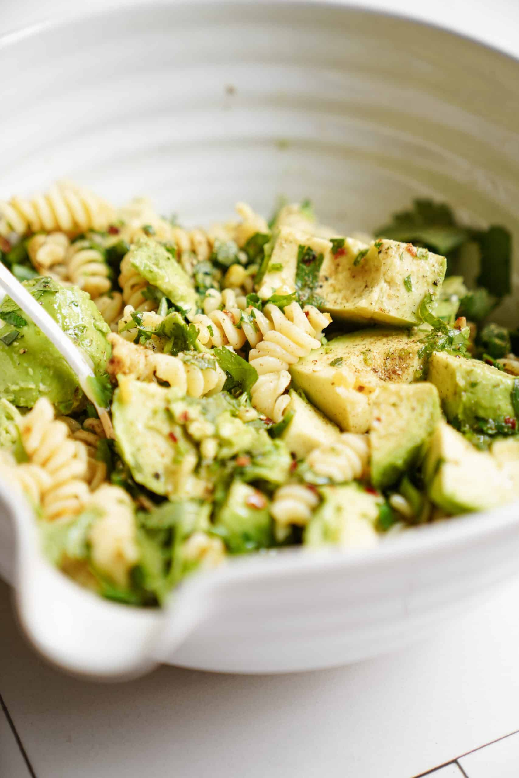 avocado pasta salad close-up in bowl
