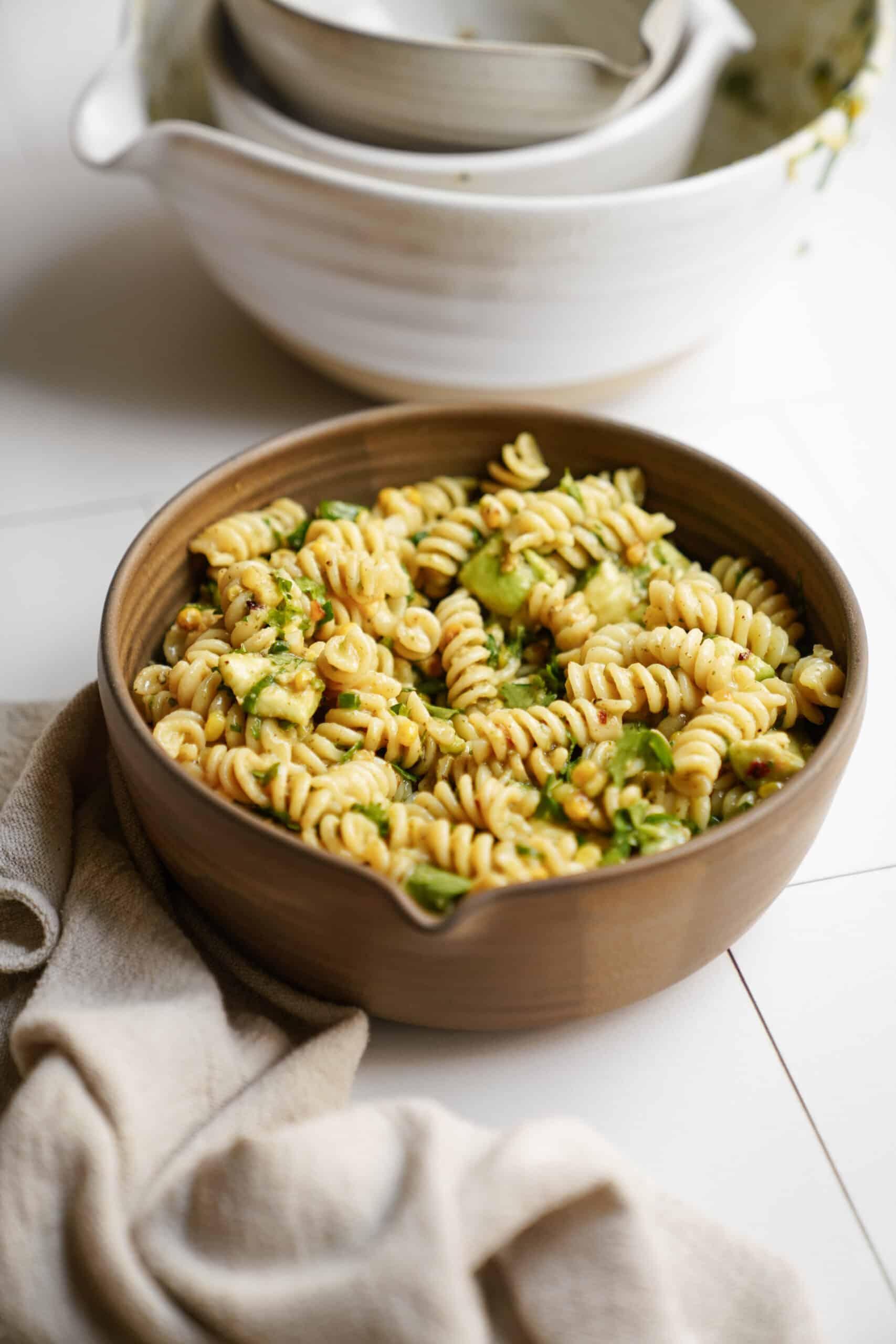avocado pasta salad in serving bowl