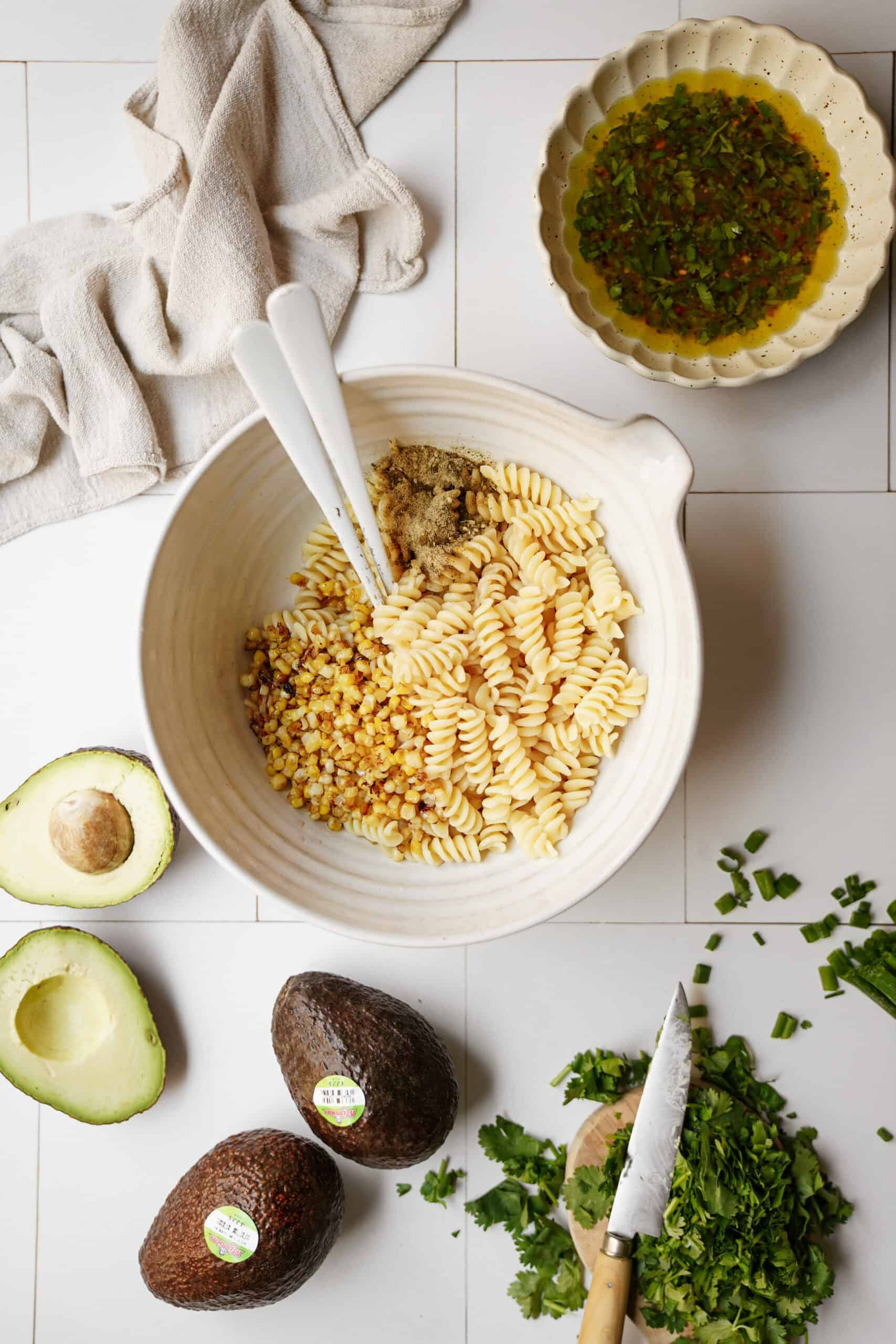 Ingredients for avocado pasta salad on a countertop