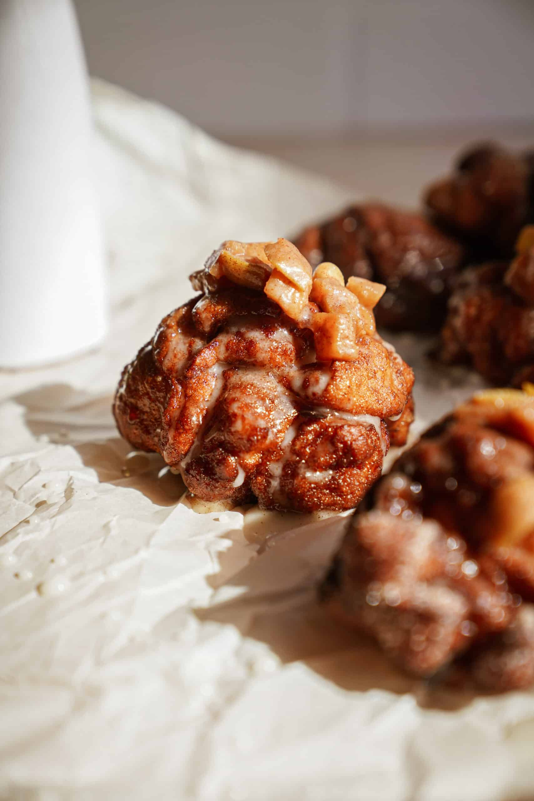 Apple fritters on parchment paper
