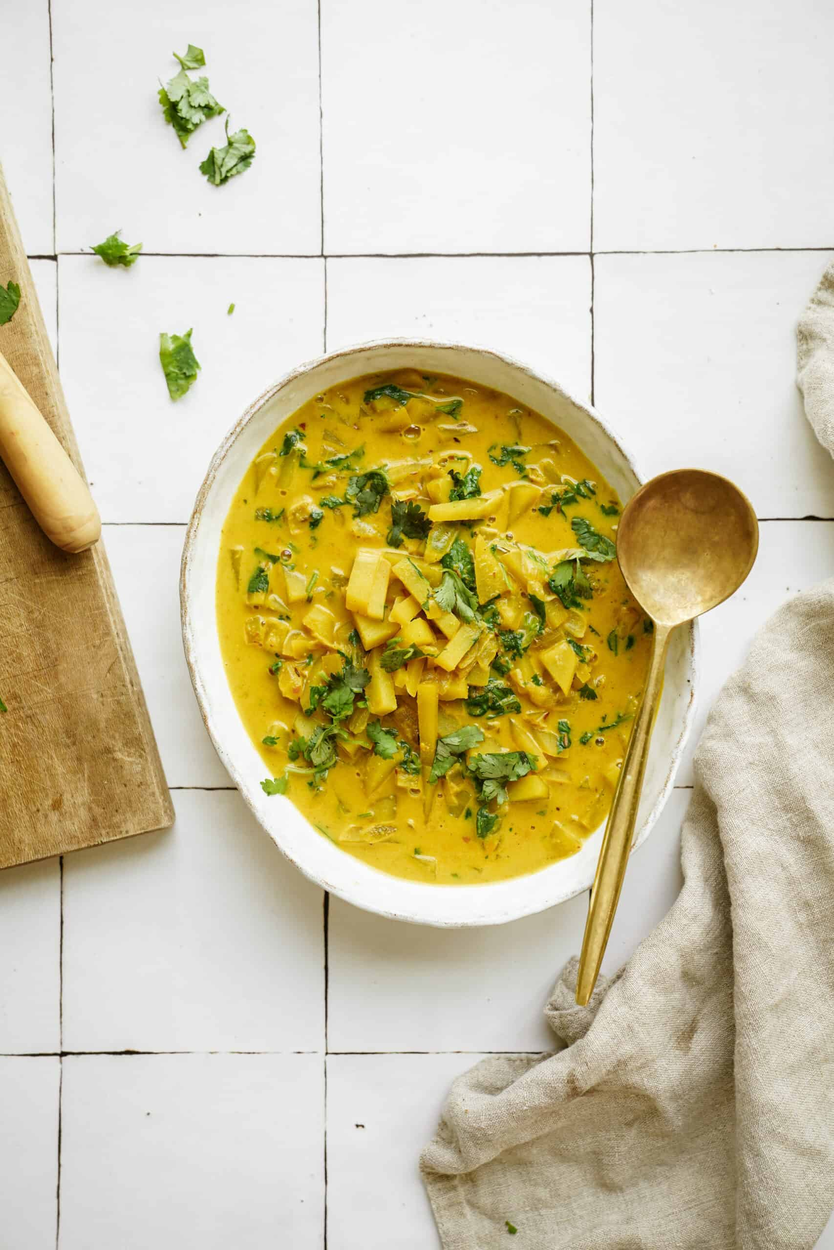 Curry potato soup in a large serving dish