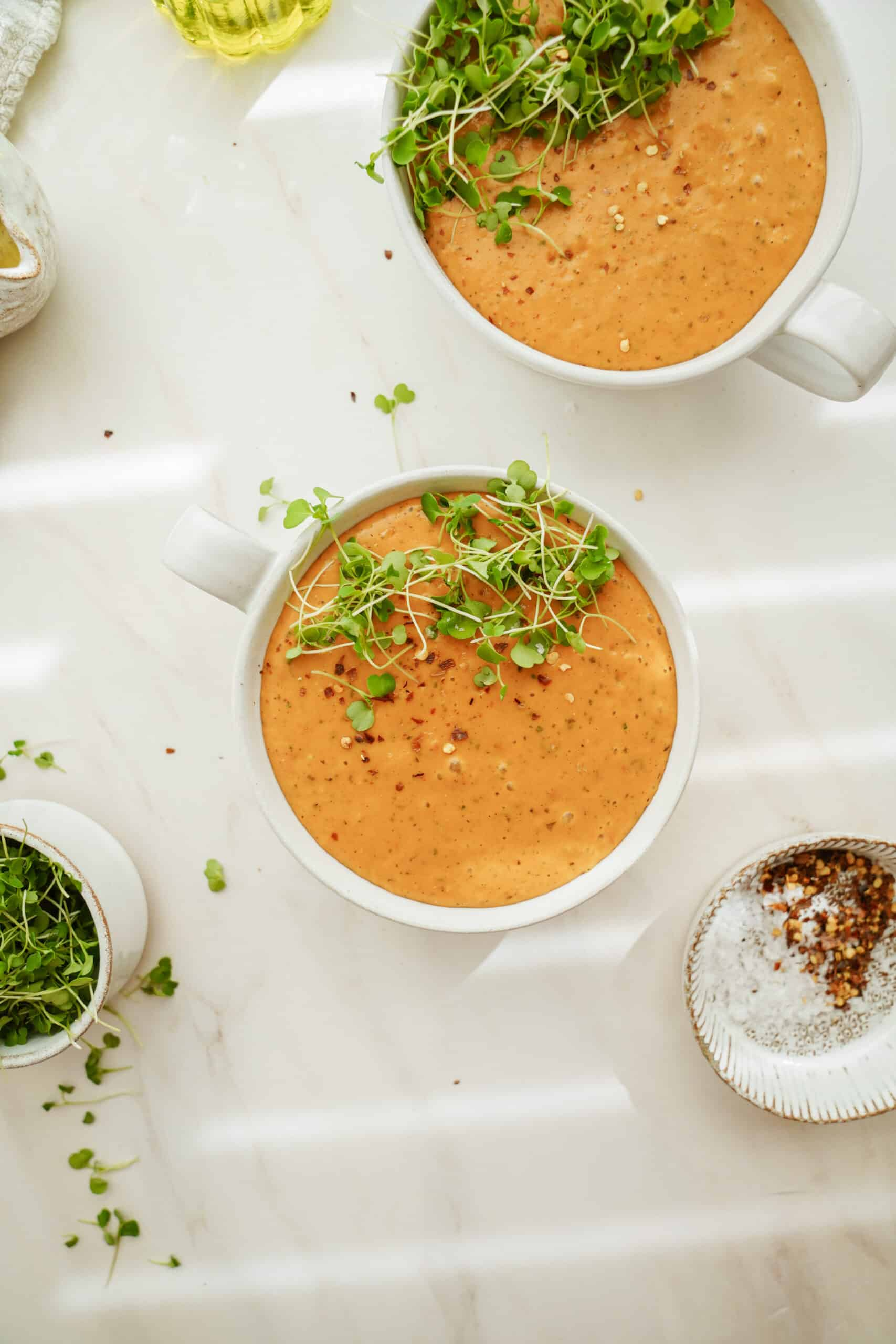 Creamy tomato soup in a white bowl