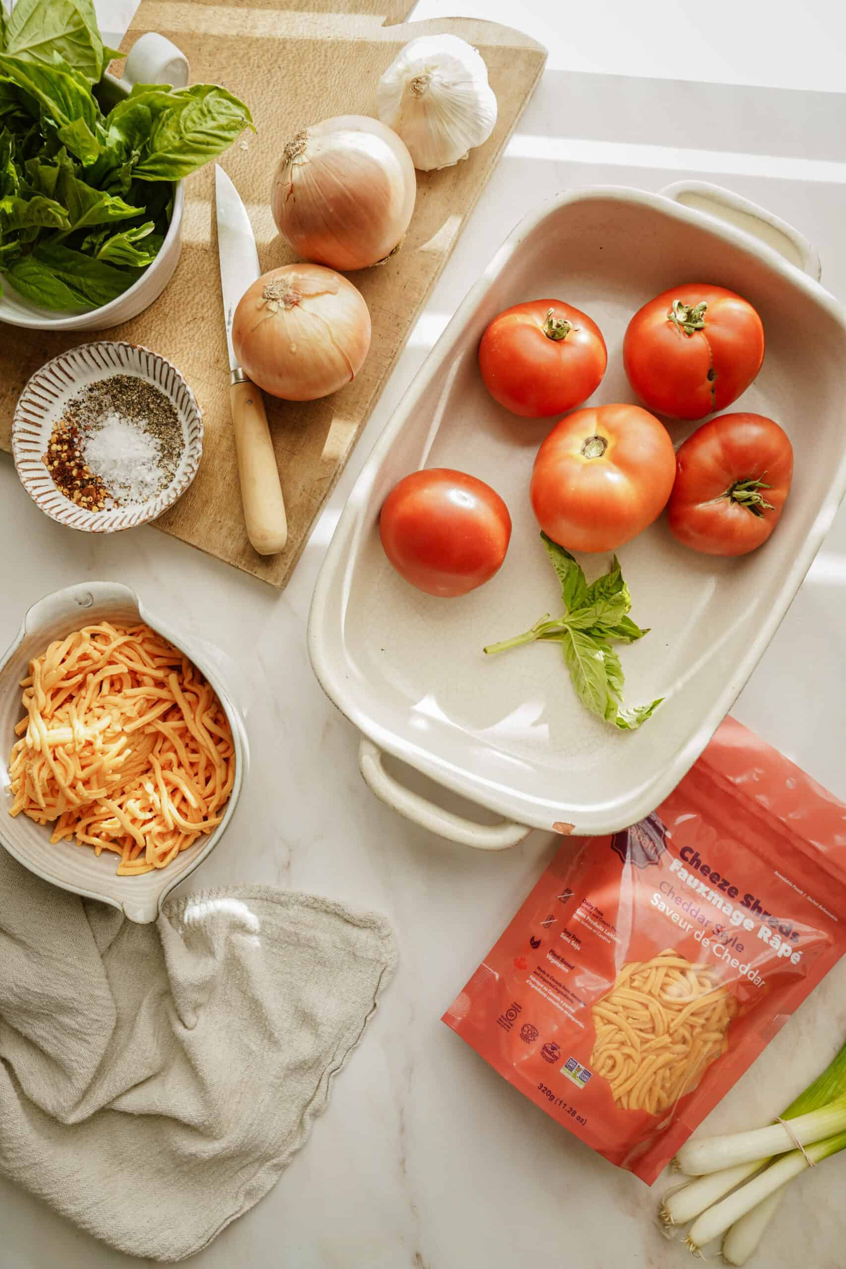 Ingredients for creamy tomato soup in a casserole dish