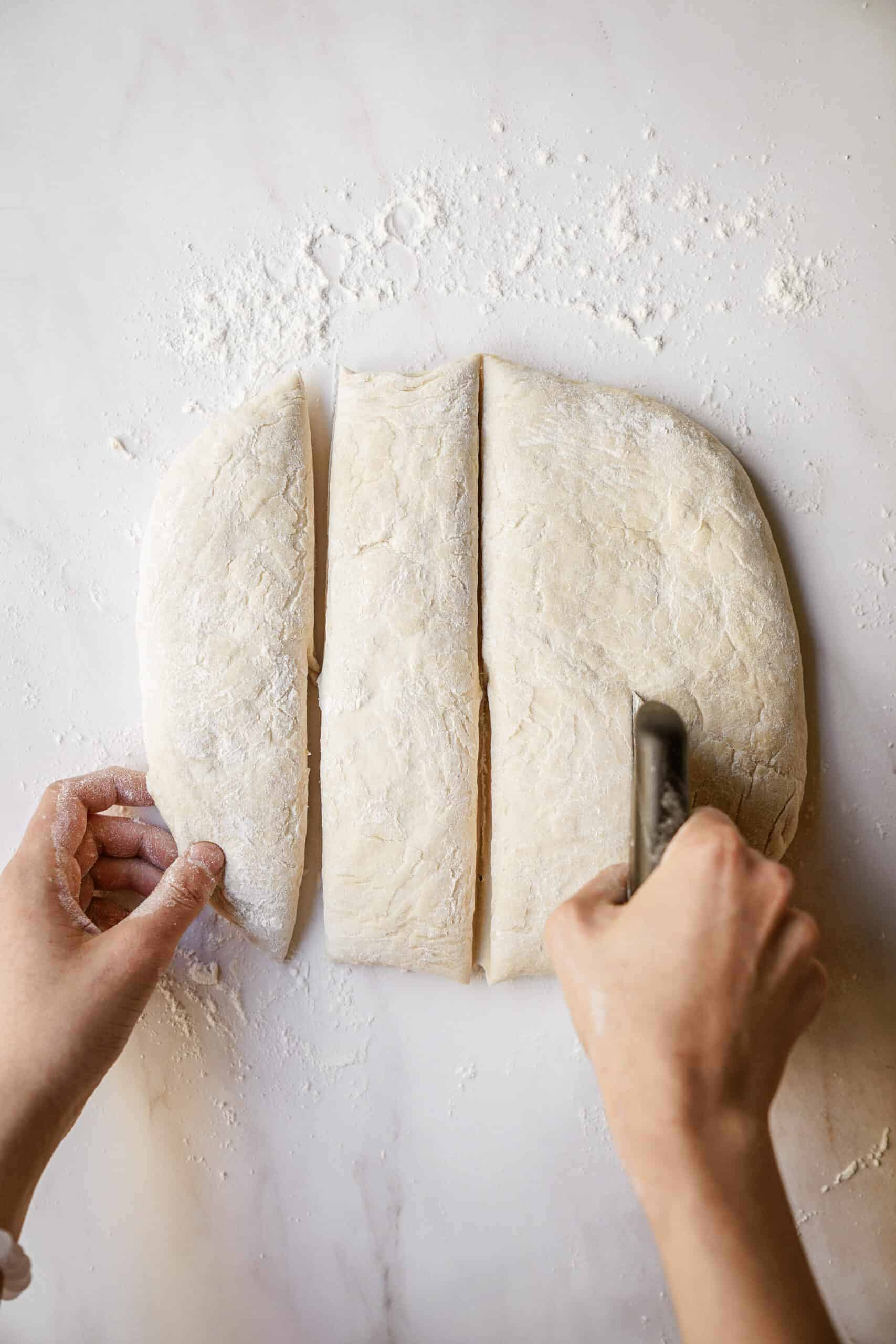 Dough being cut into squares