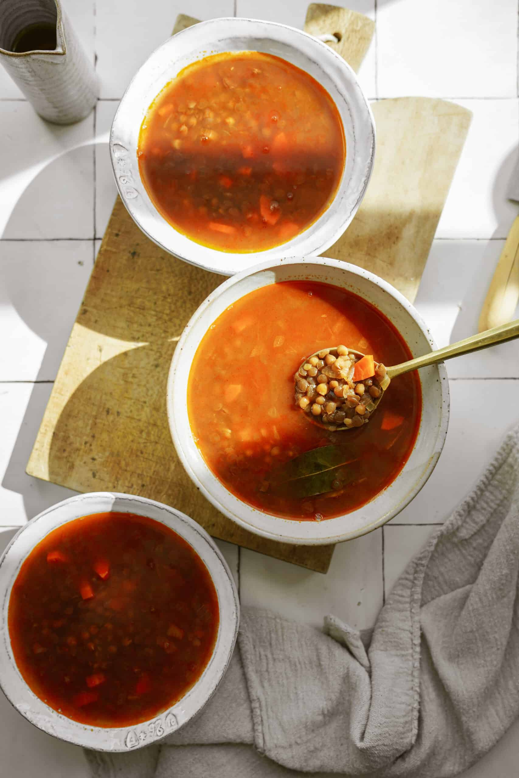 Greek lentil soup (fakes) in white bowls