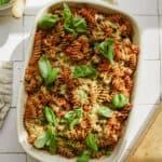Pesto pasta bake in a casserole dish